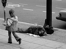 220px-Man_sleeping_on_Canadian_sidewalk
